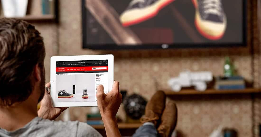 man shopping online using tablet