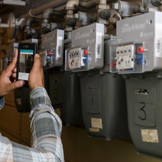 worker scanning gas meter