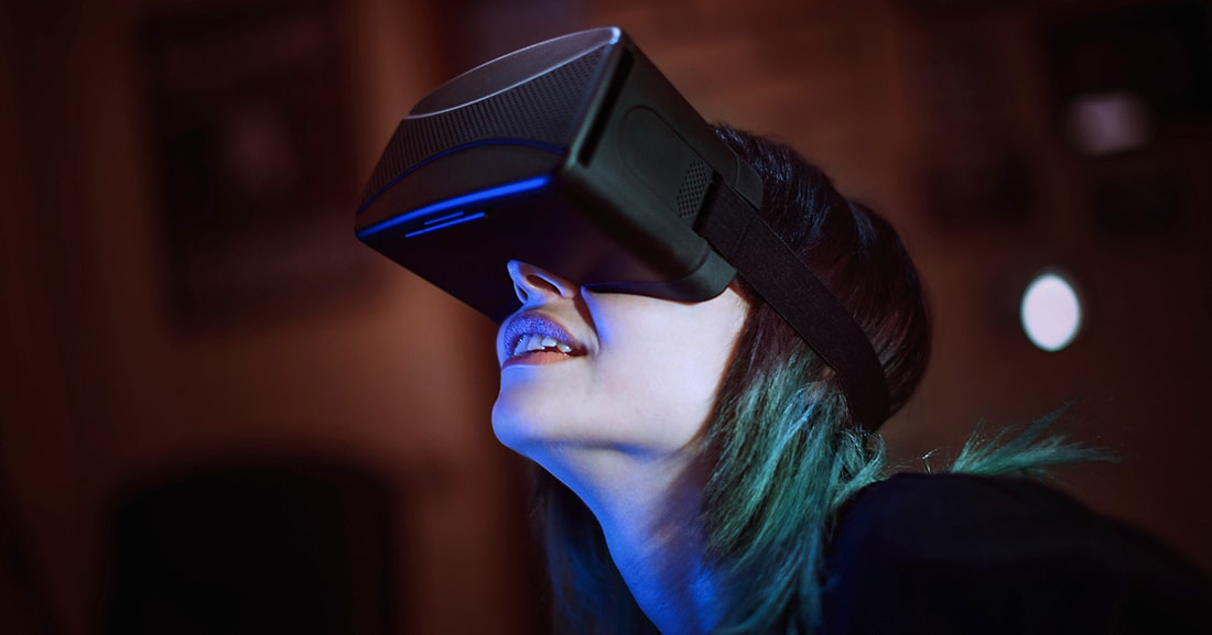 woman using VR headset