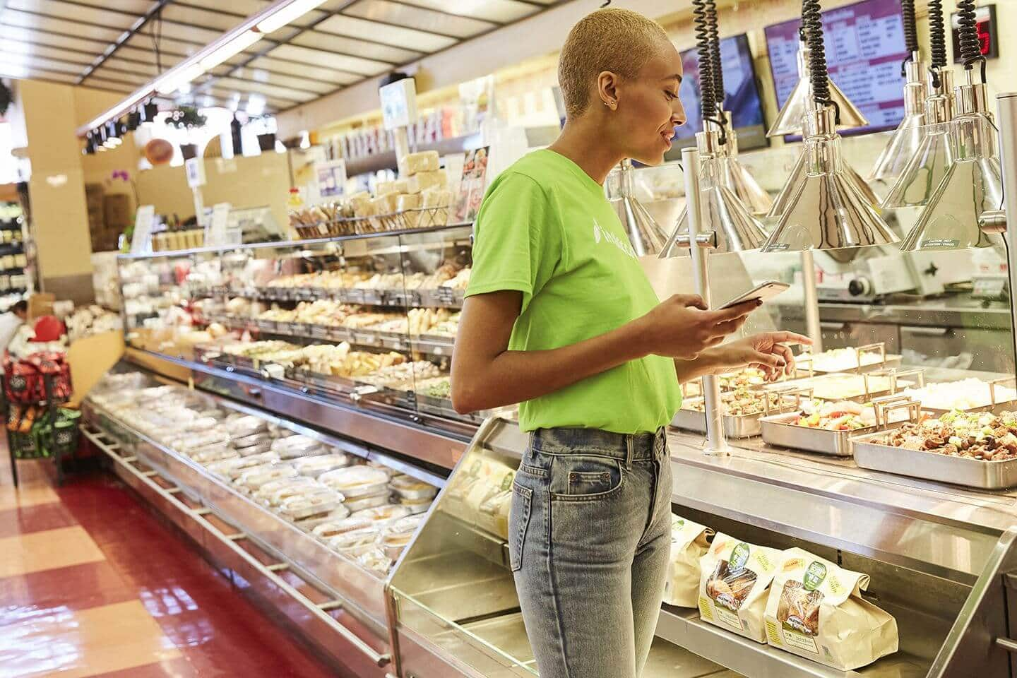 employee working serving sample food products