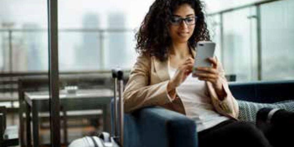 smiling woman navigating on phone