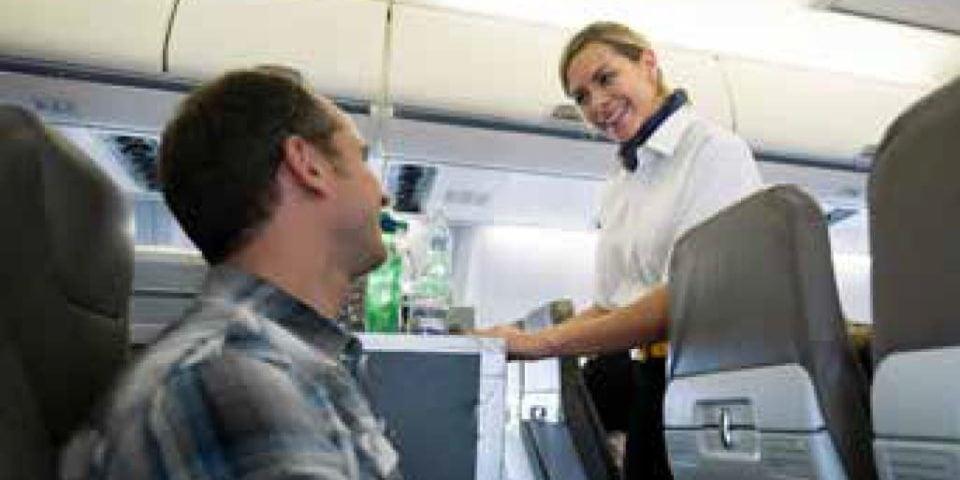 Stewardese serving customers