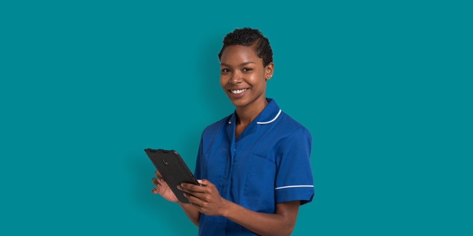 smiling woman holding a tablet