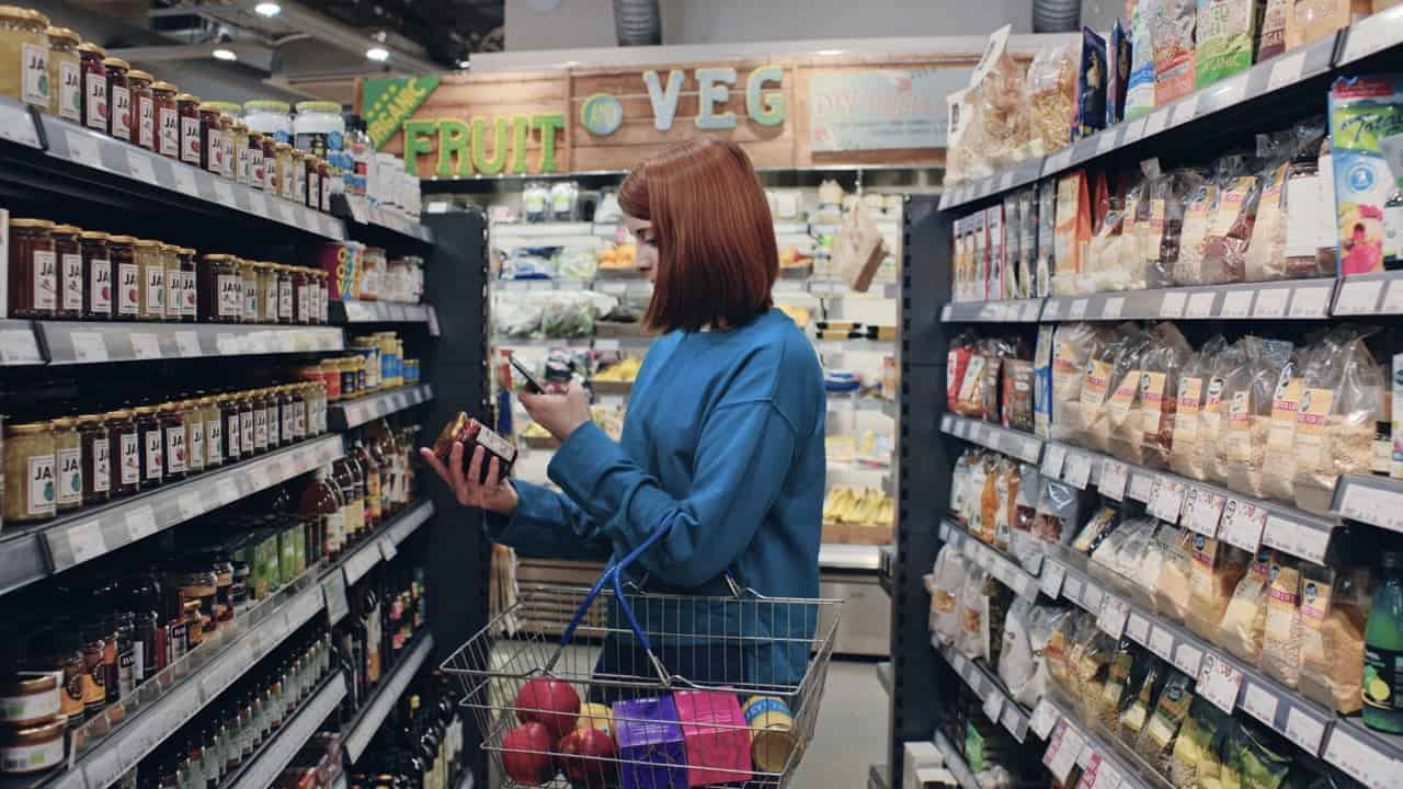 Customer Using Store App to Scan Shelves and Find Products