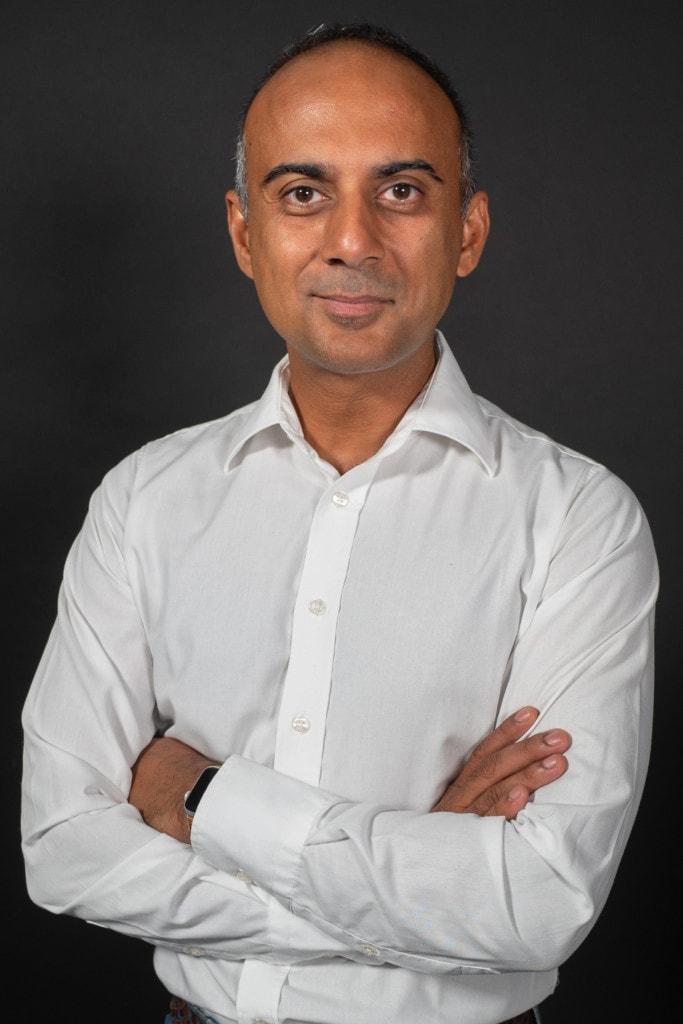 smiling man dressed in white shirt