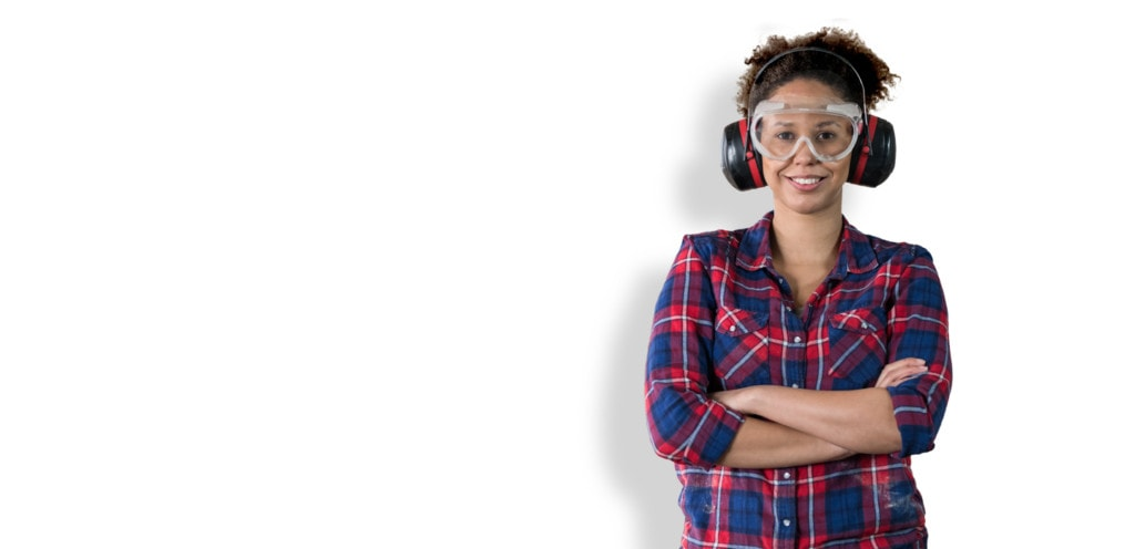 smiling woman wearing ear and eye protection
