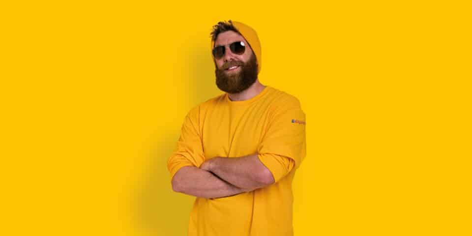 smiling man dressed in yellow