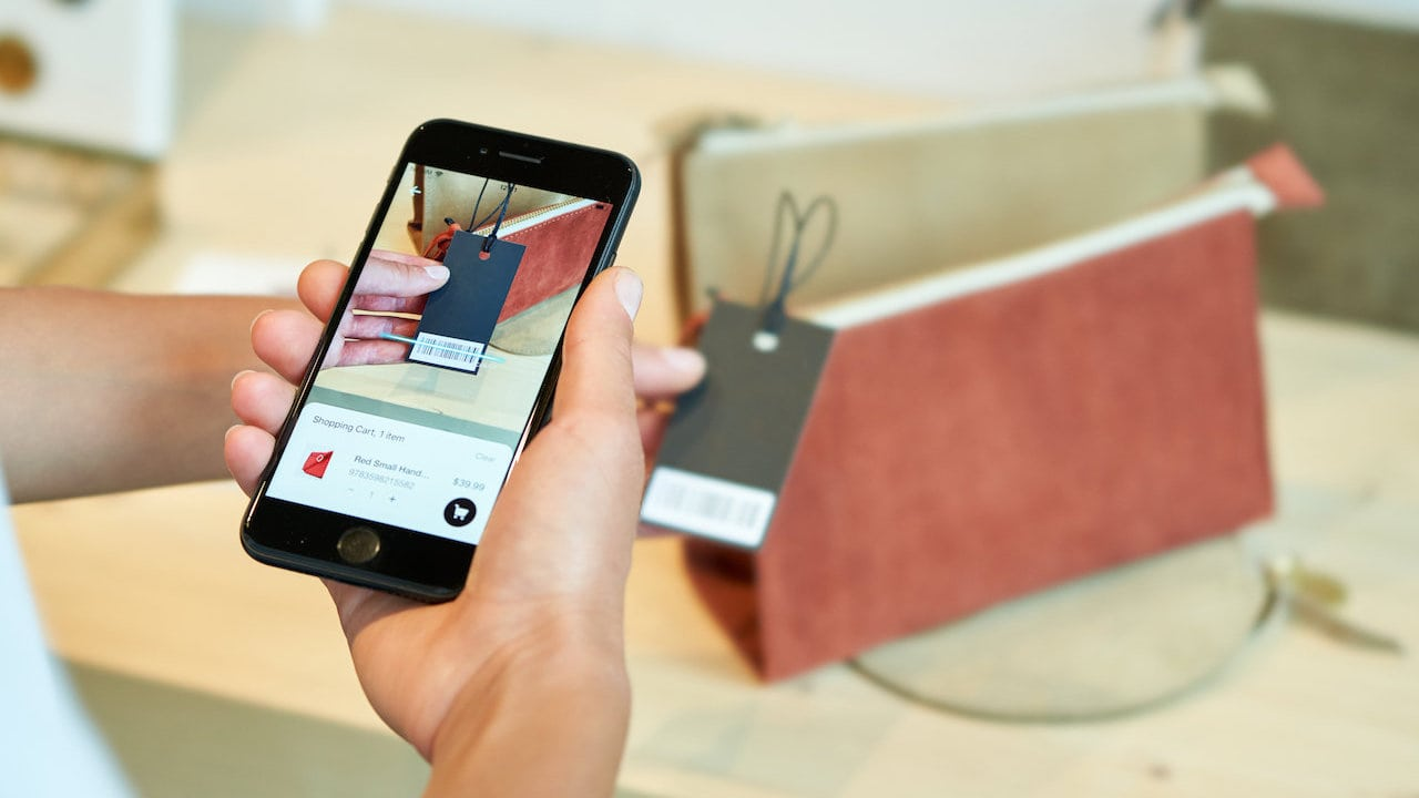 User scanning a product in store with Smarphone scanner