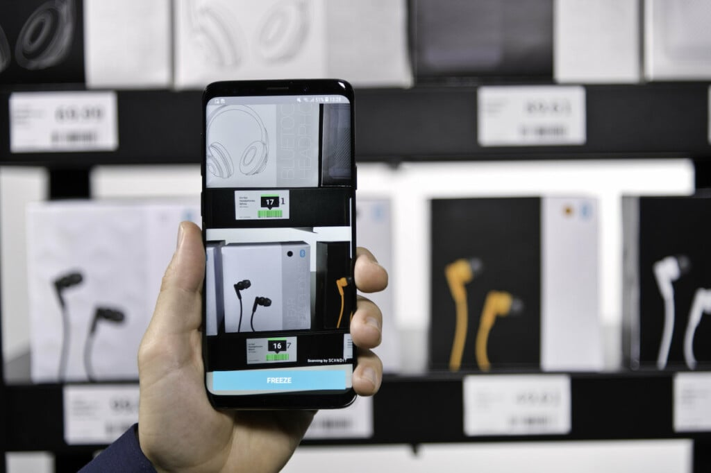 Smartphone scanning multiple items on shelf
